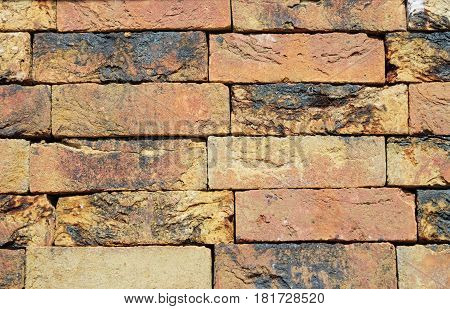 Old brick textured wall. Background of old vintage brick wall. Close up on Vintage brick wall photo. Brick wall textured background.