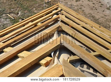House Roof Corner Roofing Construction. Install House Roof with Wooden Trusses and Insulation Membrane. Roof repair.