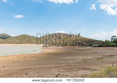 STOMPDRIFT SOUTH AFRICA - MARCH 23 2017: The holiday resort and nearly empty Stompdrift dam near De Rust in the Western Cape Province