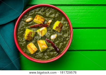 Indian curry dish - Palak paneer made up of  spinach and cottage cheese, served in white bowl, selective focus