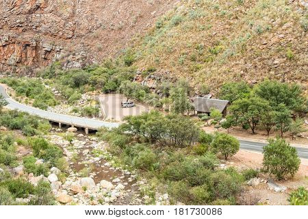 MEIRINGSPOORT SOUTH AFRICA - MARCH 23 2017: The picnic area and toilets next to the bridge at the waterfall in the scenic Meiringpoort in the Western Cape Province of South Africa