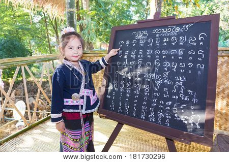 Chiangrai -thailand December 7: Unidentified Girl Tai Lue In Tribal Dress And Tai Lue Language On De