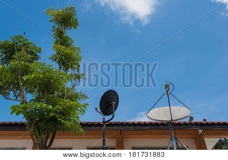 Two satellite dish with a beautiful blue sky background.