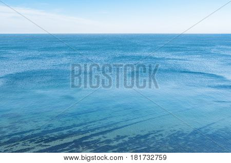 Horizon line - between sky and water on the bleack sea.