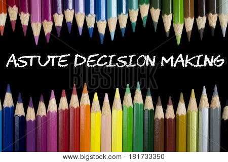 Colorful pencil crayons with text Astute Decision Making on black background