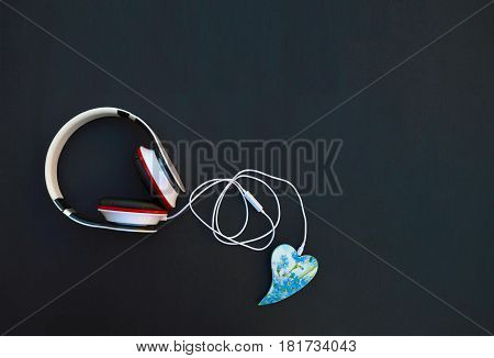 Headphones and heart. Concept. Listen to your favorite music. Listen to your heart. Music of love. I love music. Connector included with heart. Love. Melody of Spring. Top view. Space for text.