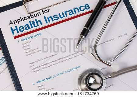 Application Form For Health Insurance, Paperwork, Questionnaire With Pen And Stethoscope. Health Ins