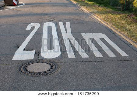 Speed limit 20 painted on asphalt (Germany)