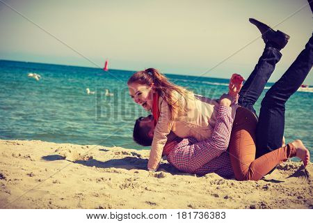 Romance beautiful relantionship concept. Happy couple date on beach near sea having fun laughing and fooling around.