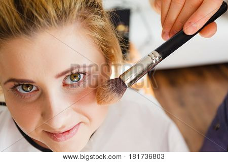 Woman Getting Face Makeup Done