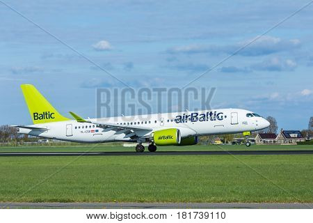 Amsterdam Schiphol Airport the Netherlands - April 14 2017: air baltic aircraft landing at Amsterdam Schiphol airport