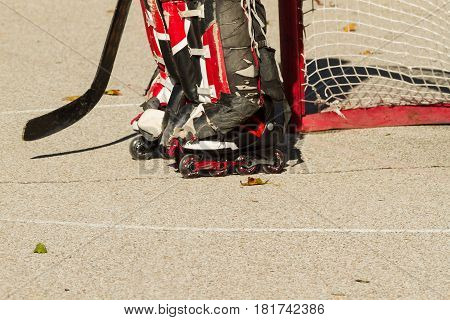 A hockey goalie waiting for play to resume