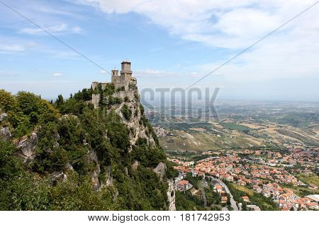 San marino. Emilia-Romagna. Castle on the rock and view of town on blue sky background horizontal view