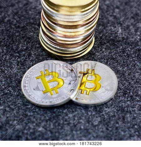 Two Silver Bitcoin Coins Near Money Column