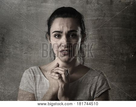 beautiful face of sad woman crying desperate and depressed with tears on eyes suffering pain and depression isolated on dirty grunge background in sadness facial expression emotion concept