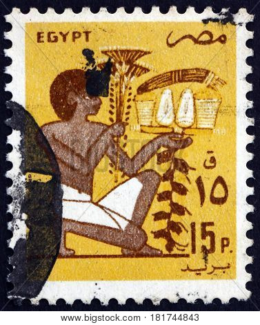 EGYPT - CIRCA 1985: a stamp printed in Egypt shows Slave Bearing Votive Fruit Offering Mural circa 1985