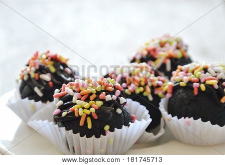 chocolate ball cake topping colorful candy in paper tray