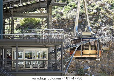 PALM SPRINGS, CALIFORNIA - MARCH 25, 2017: Palm Springs Aerial Tramway. Closeup of a tram car docking at the Valley Station.
