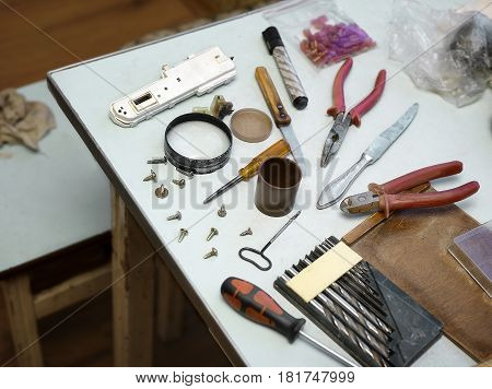Work tools spread out on a kitchen table