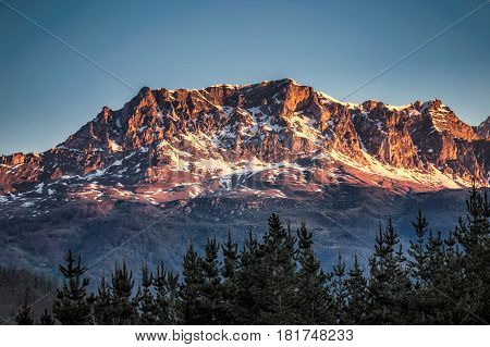 Sunrise over Peaks of Europe ridge with wooden fence, Cantabria,Spain.