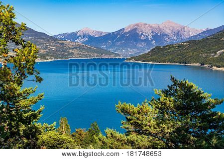 Serre-Poncon lake in Summer with the Savines-le-Lac bridge in the distance. Hautes-Alpes Paca region Souther French Alps France