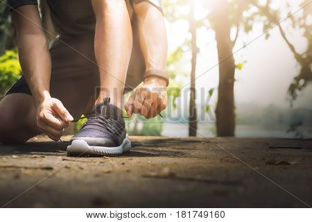 Young Man Runner Tying Shoelaces.