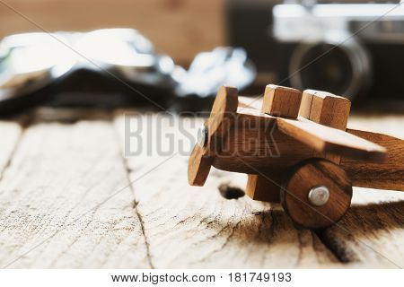 Travel idea copyspace background concept. Balsa wood model airplane on desk with copy space travel concept.