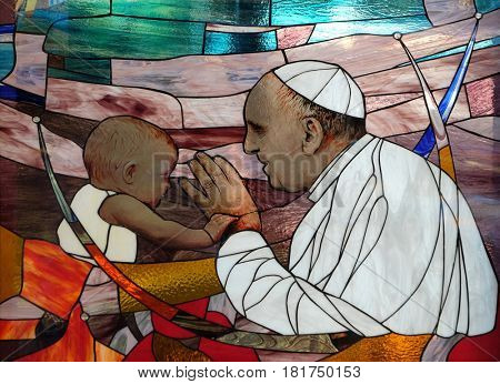 TIRANA, ALBANIA - SEPTEMBER 27: Pope Francis, stained glass window in St Paul's Cathedral in Tirana, Albania on September 27, 2016.