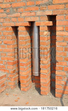 Chimney Pipe installation in brick wall. Direct Vent Fireplace Pipes and Exhausts. Coaxial metal chimney pipe.