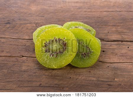 CloseUp Dried kiwi on wooden background. food