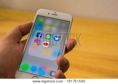 BANGKOK THAILAND - May 4 2017: Social media app icons on Iphone6 screen smartphone in person's hand: Cyber mobile online wireless wifi technology lifestyle digital 4.0 age anywhere everyday