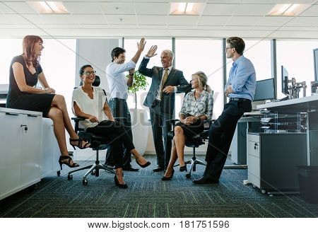 Business Team Enjoying Success At Office