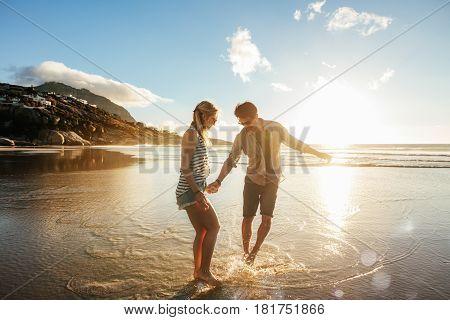 Beautiful Young Couple Having Fun On Beach