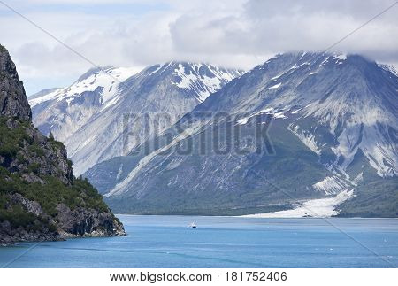 The small boat passing by in Glacier Bay national park (Alaska).