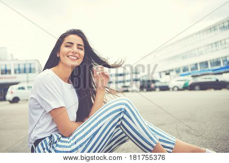 Woman With Wind Blown Hair And Striped Pants