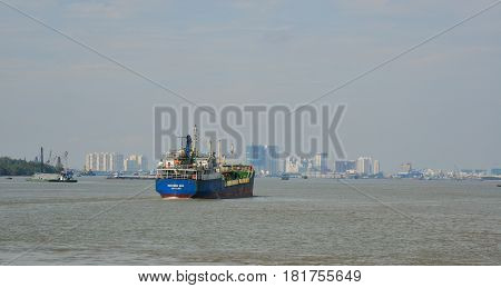 Cargo Ships On The Saigon River In Southern Vietnam