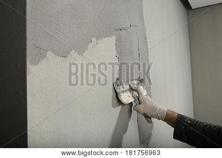 Applying Cement with Plastering Trowel