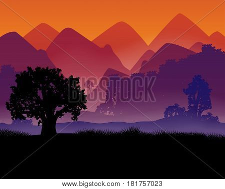 Silhouette of a tree against a background of mountains and fog