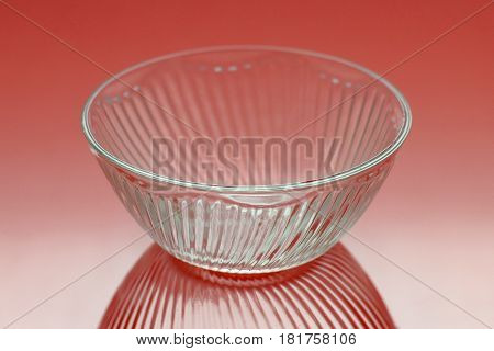 Deep round glass ware on red background