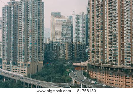 Chongqing, China - Dec 22, 2015: The View  Of Foggy Crowded City Beside The  Jialing River And Roads