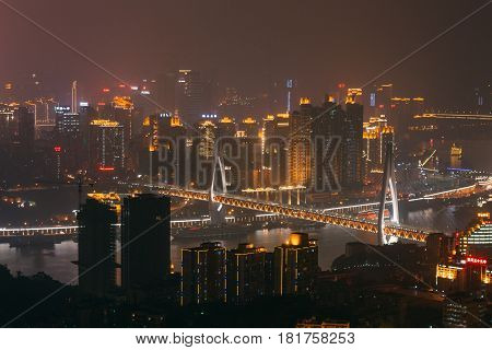 Chongqing, China - Dec 22, 2015: The Night View Of Foggy Crowded City Beside The  Jialing River