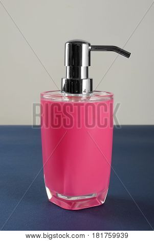 Glass bottles with liquid soap or shower gel