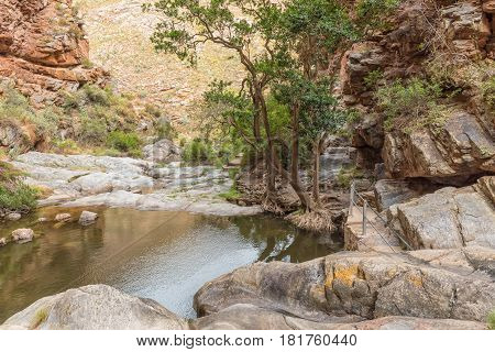 The view below the waterfall in the scenic Meiringpoort in the Western Cape Province of South Africa
