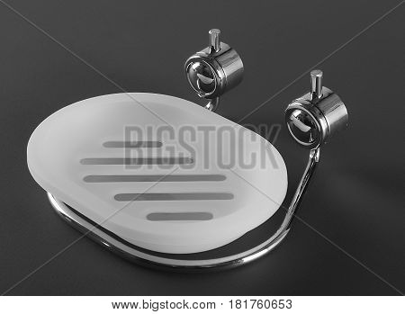 Empty whie plastic soap-dish with matal holder
