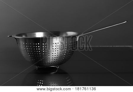 Empty sieve strainer stainless metal with handle. Front view