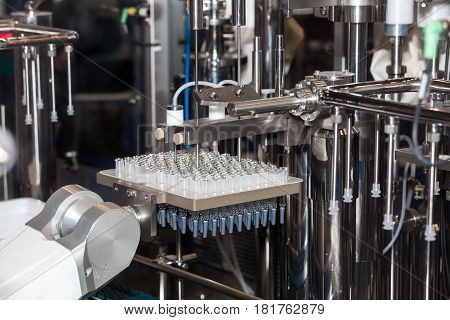 Sterile bottles and ampoules on the dispensing line, medical laboratory equipment