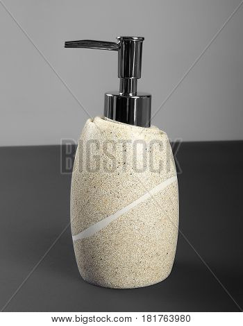 Ceramic bottles with liquid soap or shower gel front view