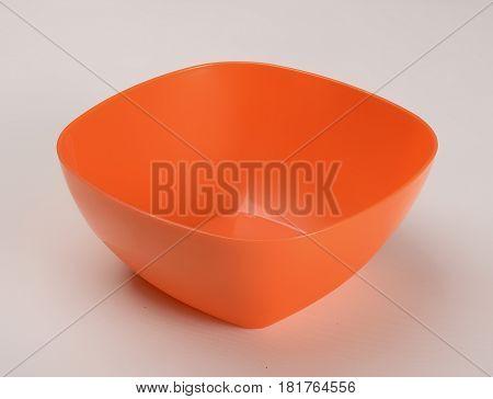 Orange plastic deep dish isolated on white background