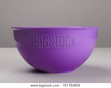 Purple plastic deep dish on the table, front view