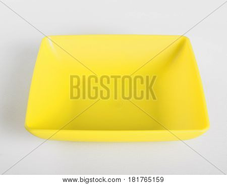 Yellow plastic shallow dish food on the table